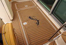 13 - Dek-King In Traditional Teak With Black Caulking - Image Courtesy Of MADECKING