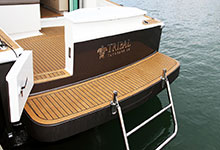32 - Dek-King In Traditional Teak With Black Caulking - Image Courtesy Of Dickey Boats
